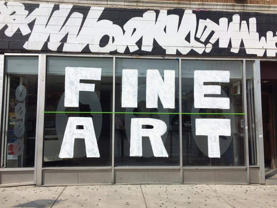 """Beauty Bar's current shop front, emblazoned with the words """"Fine Art"""" in protest to the current court case pending with Cook County."""