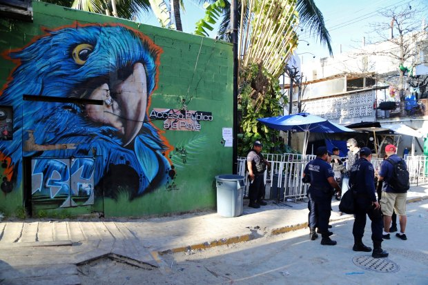 Police guard the entrance of the Blue Parrot nightclub in Playa del Carmen, Mexico